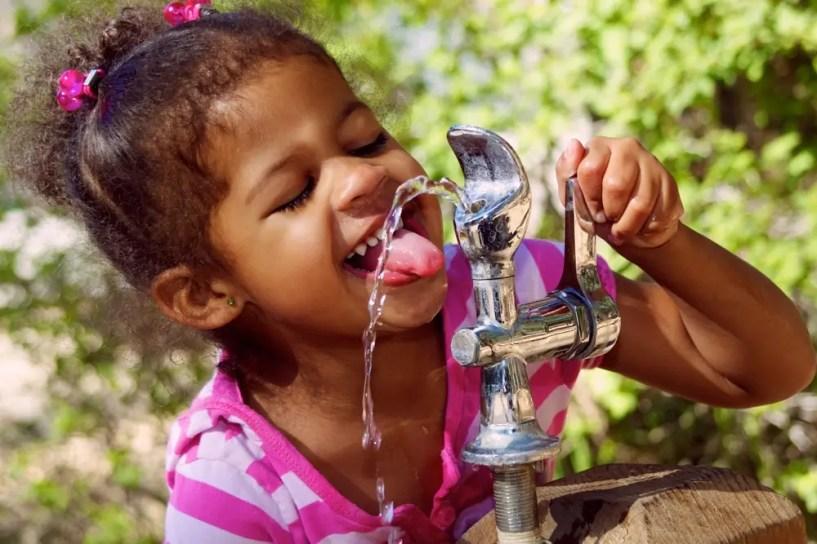 girl drinking water fountain