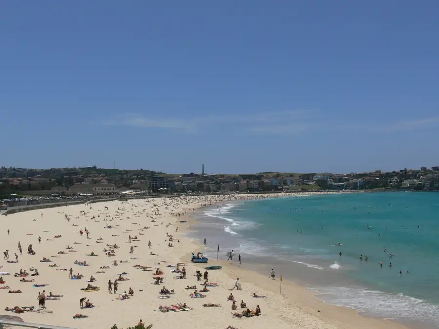 Australia's Bondi Beach, just outside of Sydney, is a beautiful enclosed beach that has strong waves for surfing and an attractive crowd of beach-goers.