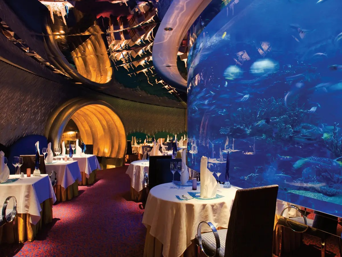 There's a floor-to-ceiling aquarium inside the restaurant. Watch the fish swim by as you dine on delicacies like caviar, oysters, and lobster. Main dishes cost anywhere from $70 to $250.