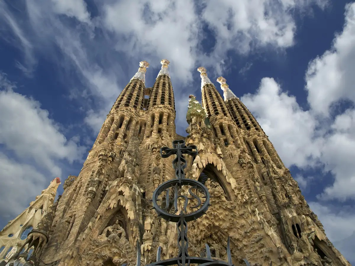 Admire the incredibly detailed facade of the Sagrada Família, a church in Barcelona, Spain, which was designed by famed architect Antoni Gaudí and has been under construction since 1882.