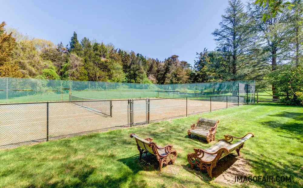 ...or play a quick match on the private tennis court. It's framed by trees on one side and faces the beach on the other, so the ocean breeze is never far away.