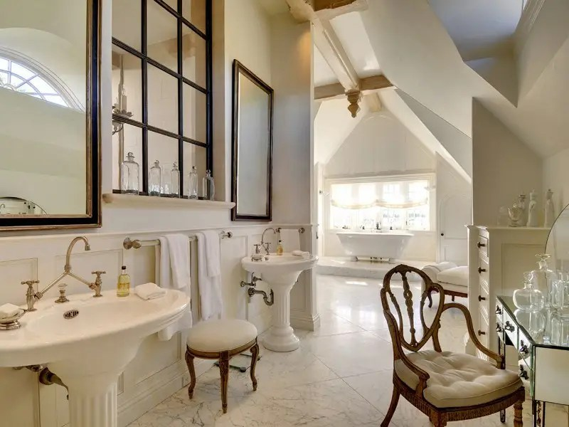 It even has its own bathroom suite with his and hers sinks, a vanity station, and epic bath tub near the window.