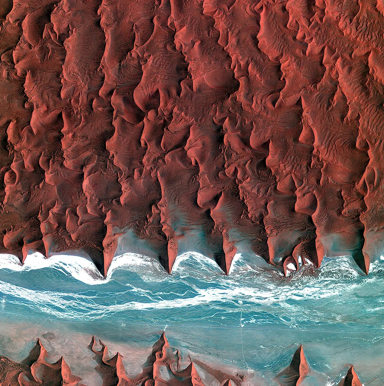 These are the dunes of the Namib Desert, taken by Korea's Kompstat-2 satellite. The blue and white area is the dried riverbed of the Tsauchab river.