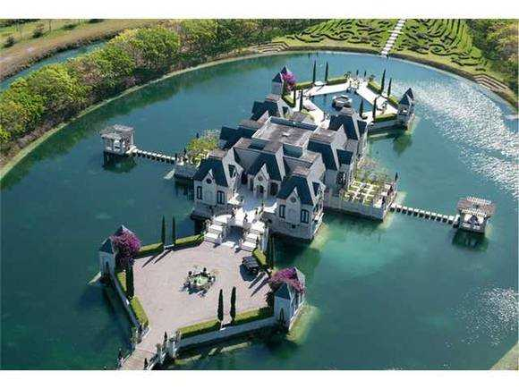 This Miami mansion has a moat.