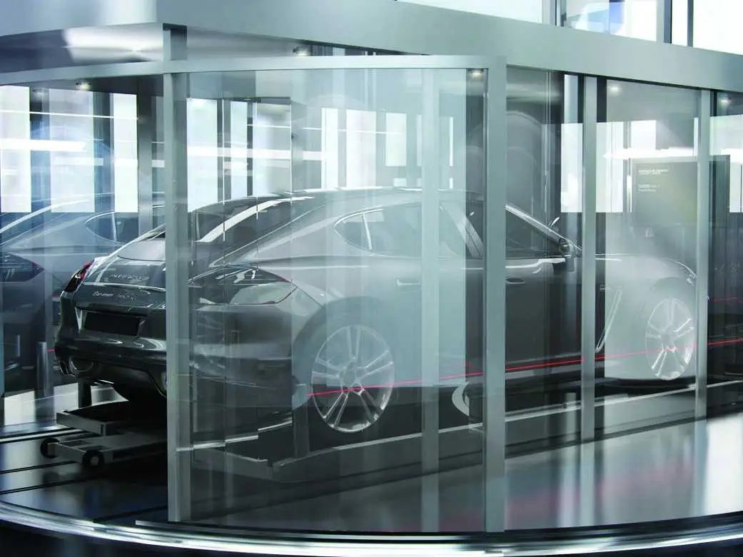 """The special elevator delivers residents and their rides directly to their front door, allowing them to park in """"sky garages"""" right next to their units."""
