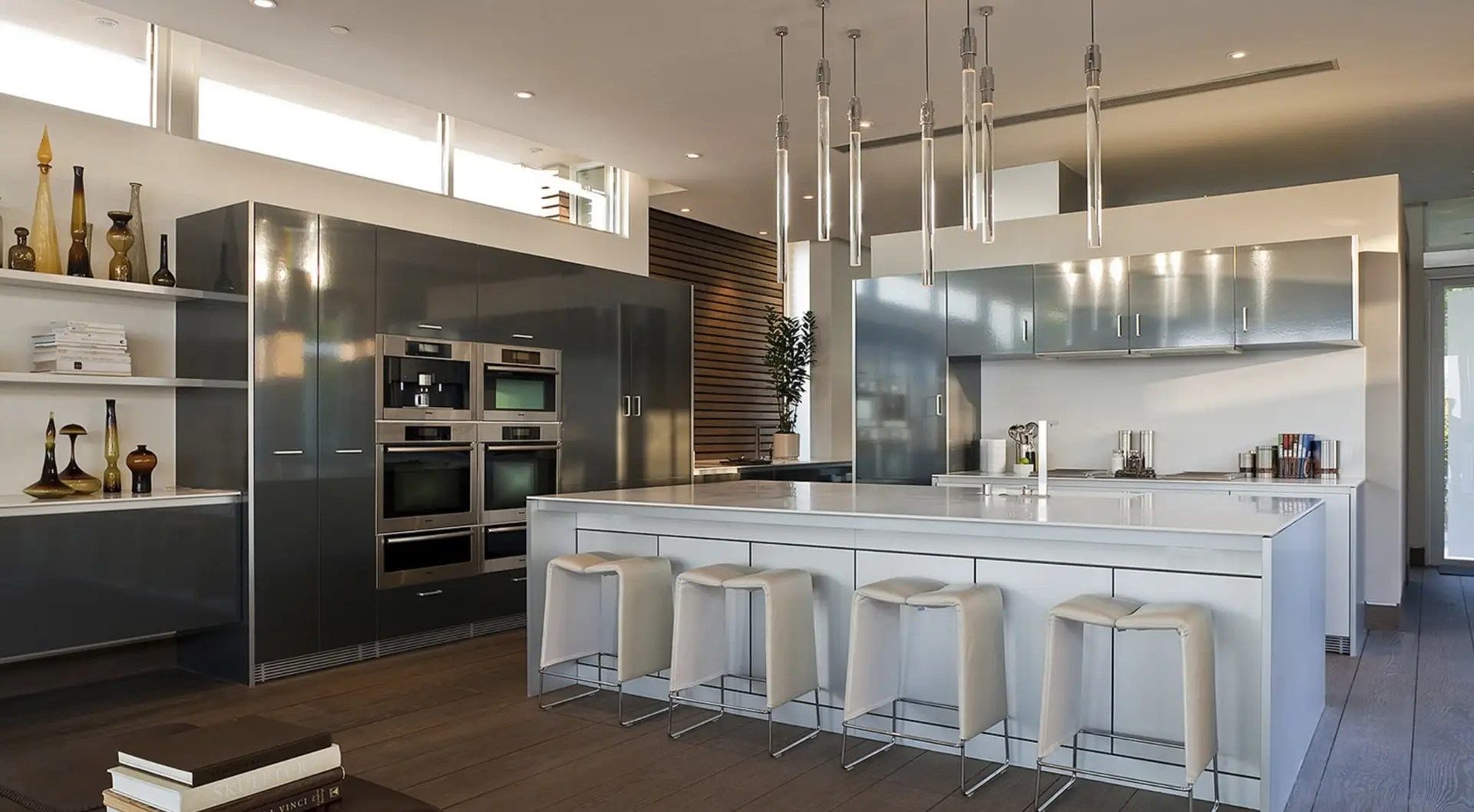 The kitchen is designed to accommodate a large party.