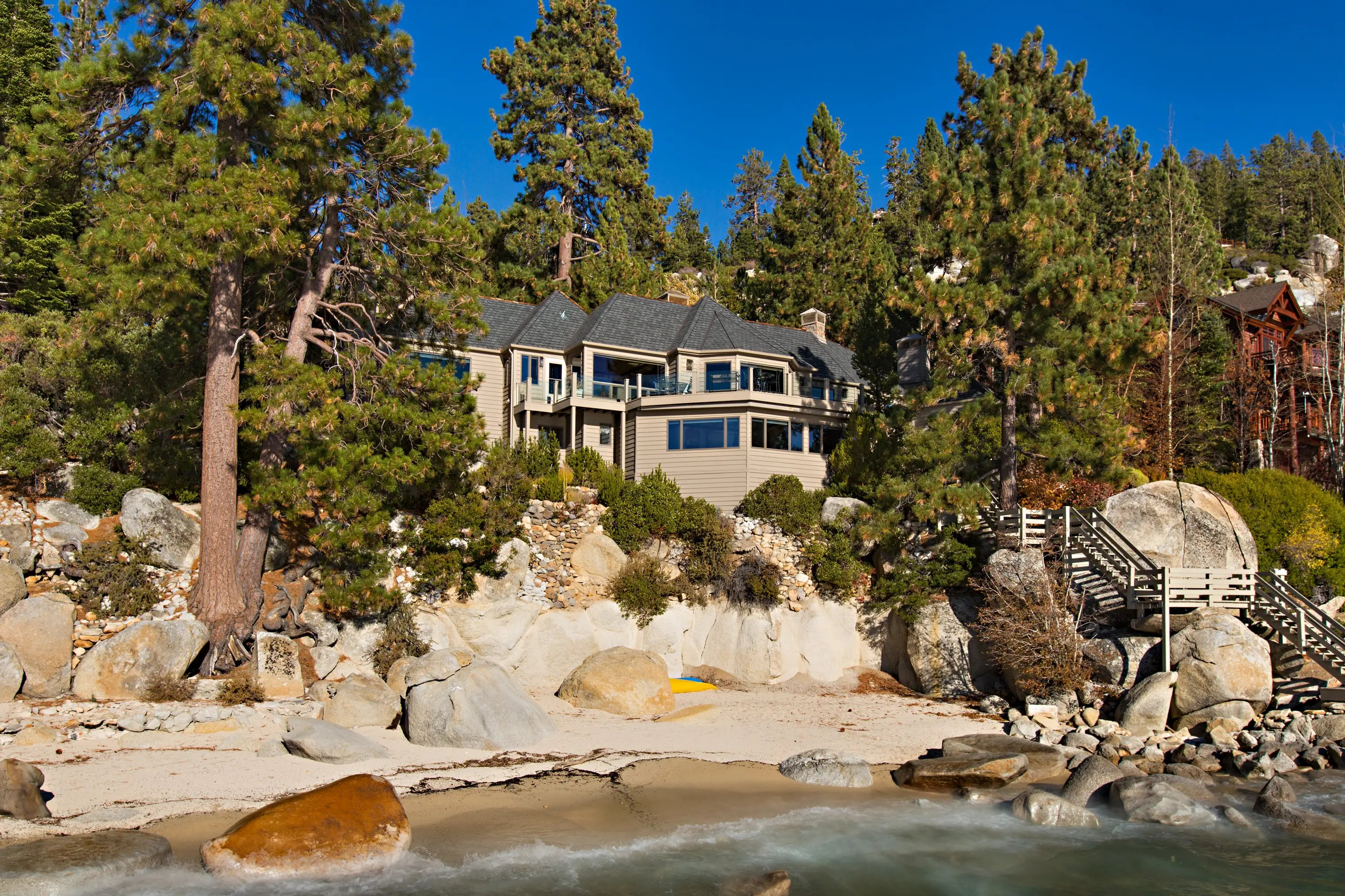 The $11.9 million home sits on a secluded one-acre lot.
