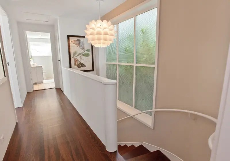 A short hallway connects the two bedrooms.