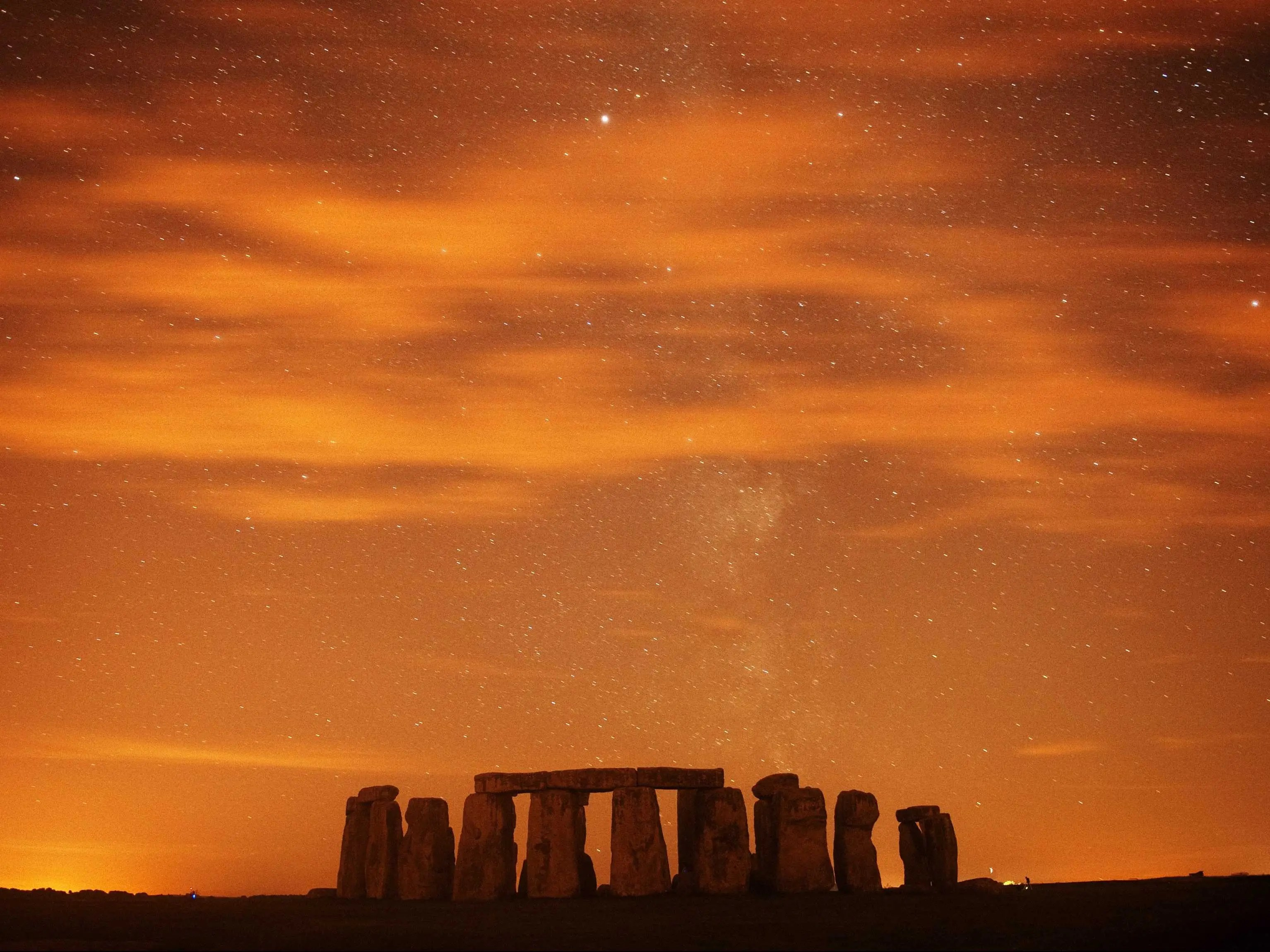 Watch the sun set at Stonehenge, in southern England.