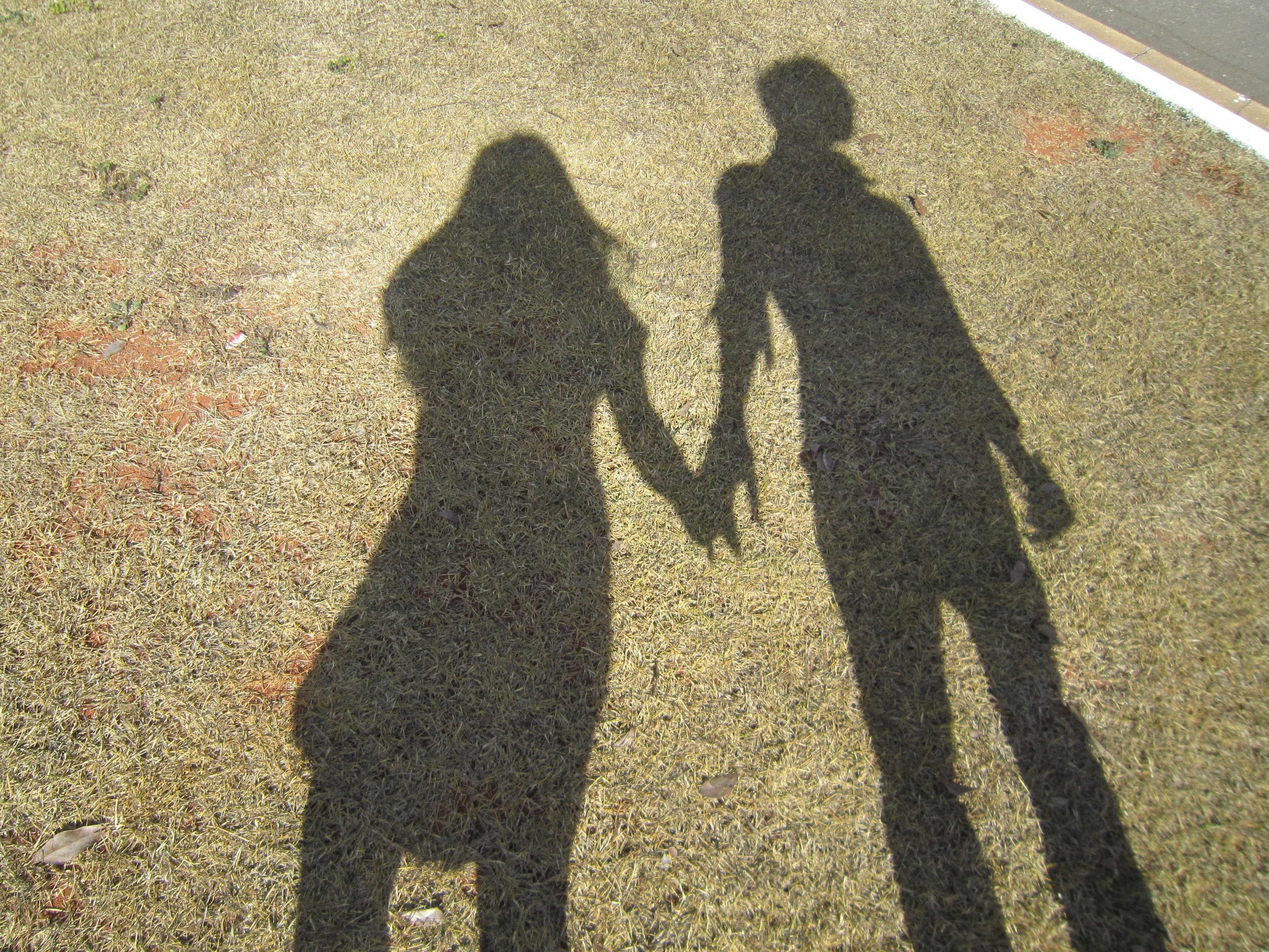 couple shadow holding hands