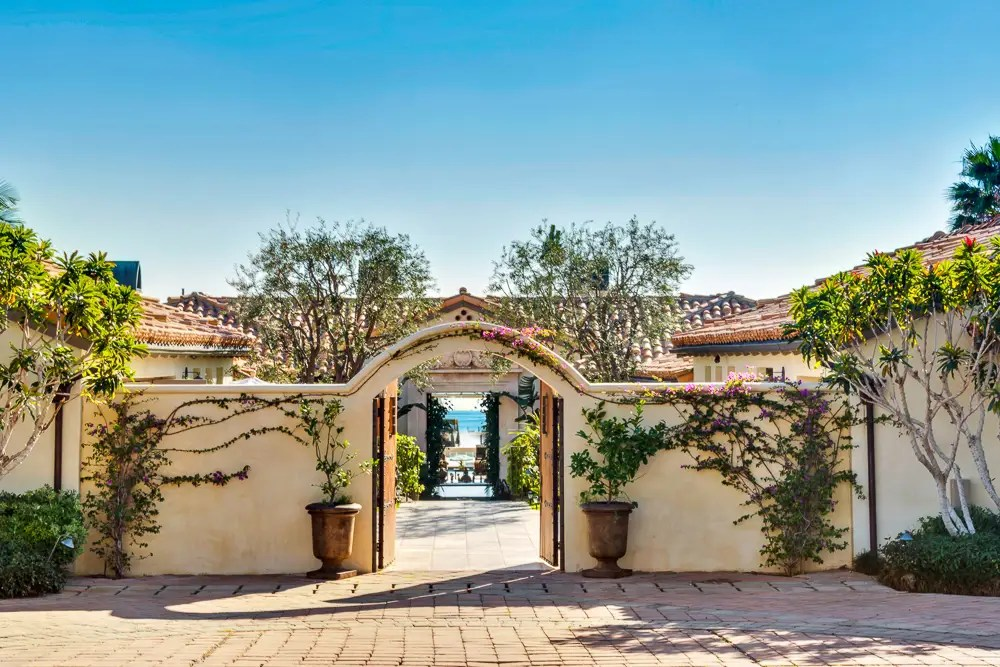 The home sits on 1.5 acres of land and has a gorgeous gate welcoming guests into the home.