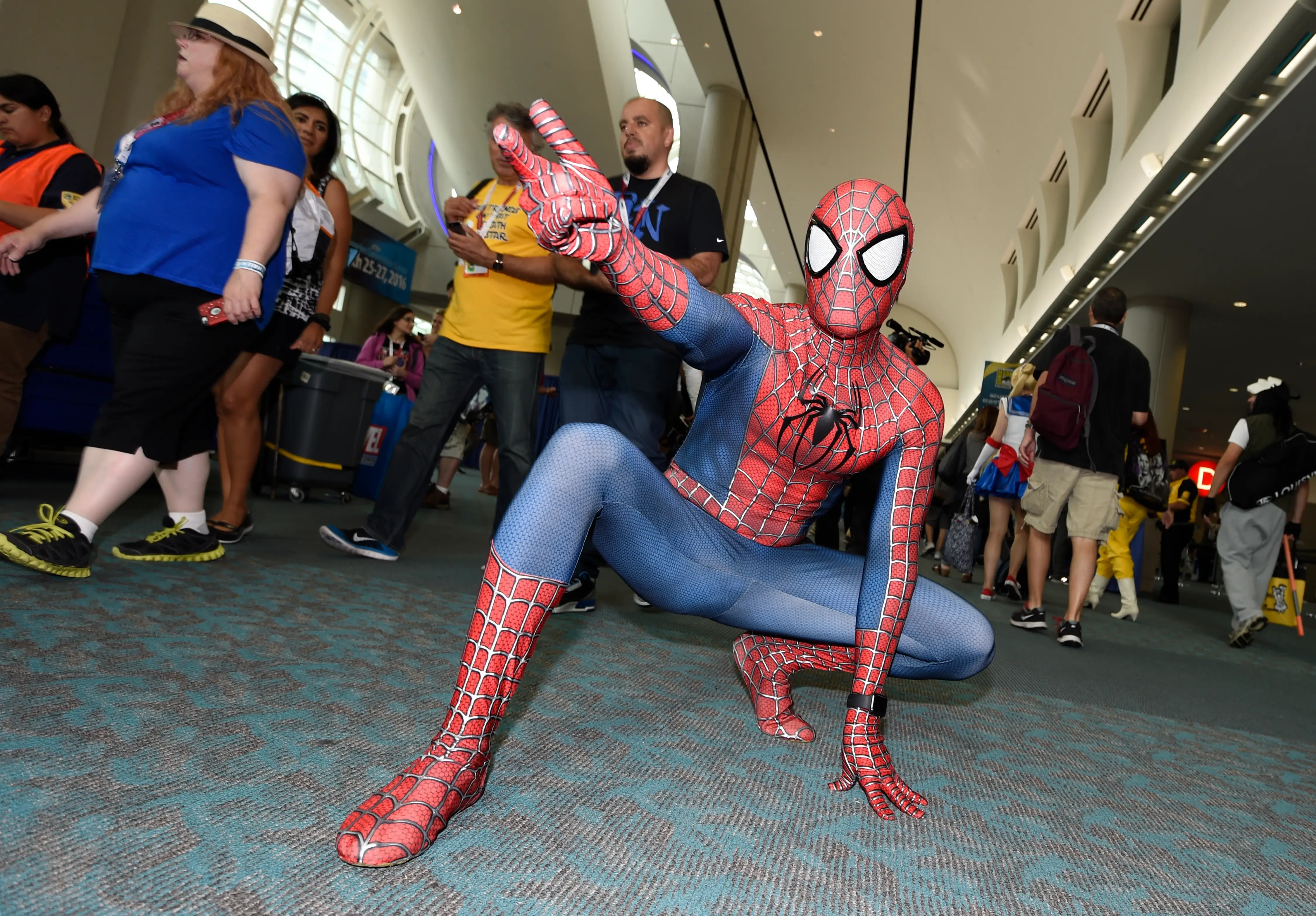 Spider-Man weaves through the crowds outside the showroom floor.