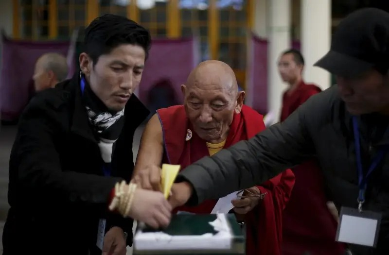 ... tibetan monk to cast his vote during the election for the tibetan