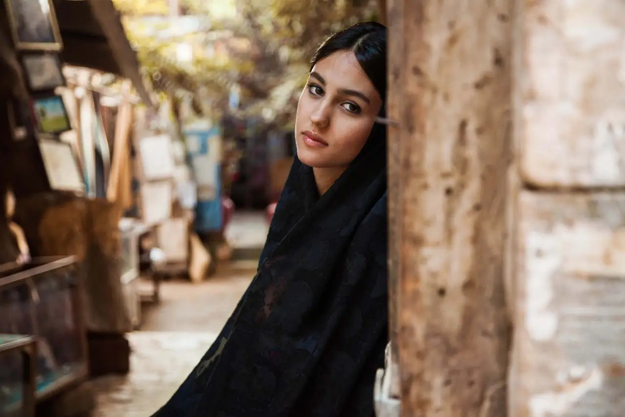 """For me, beauty is diversity, [it's] what makes us unique,"" Noroc says. ""I also believe that beauty can teach us to be more tolerant."" Below, a woman in the streets of Iran."