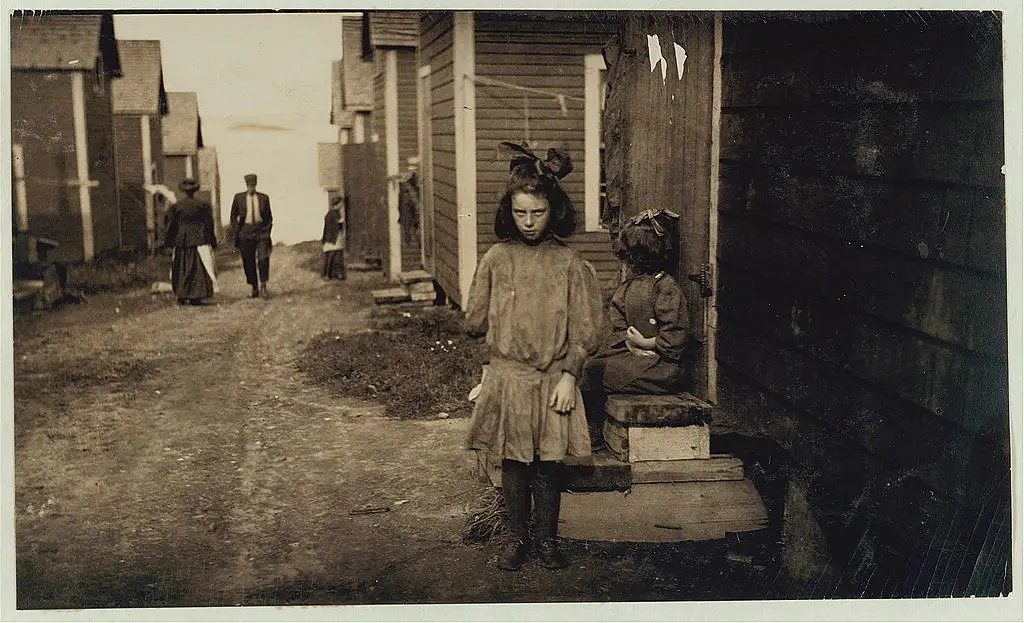 Nan de Gallant, 4 Clark Street, Eastport, Maine, a 9-year-old cartoner, Seacoast Canning Co., Factory No. 2. Packs some with her mother. Mother and two sisters work in factory. One sister has made $7 in one day. During the rush season, the women begin work at 7 a.m., and at times work until midnight. Brother works on boats. The family comes from Perry, Maine, just for the summer months. Work is very irregular. Nan is already a spoiled child. Location: Eastport, Maine, August 1911.