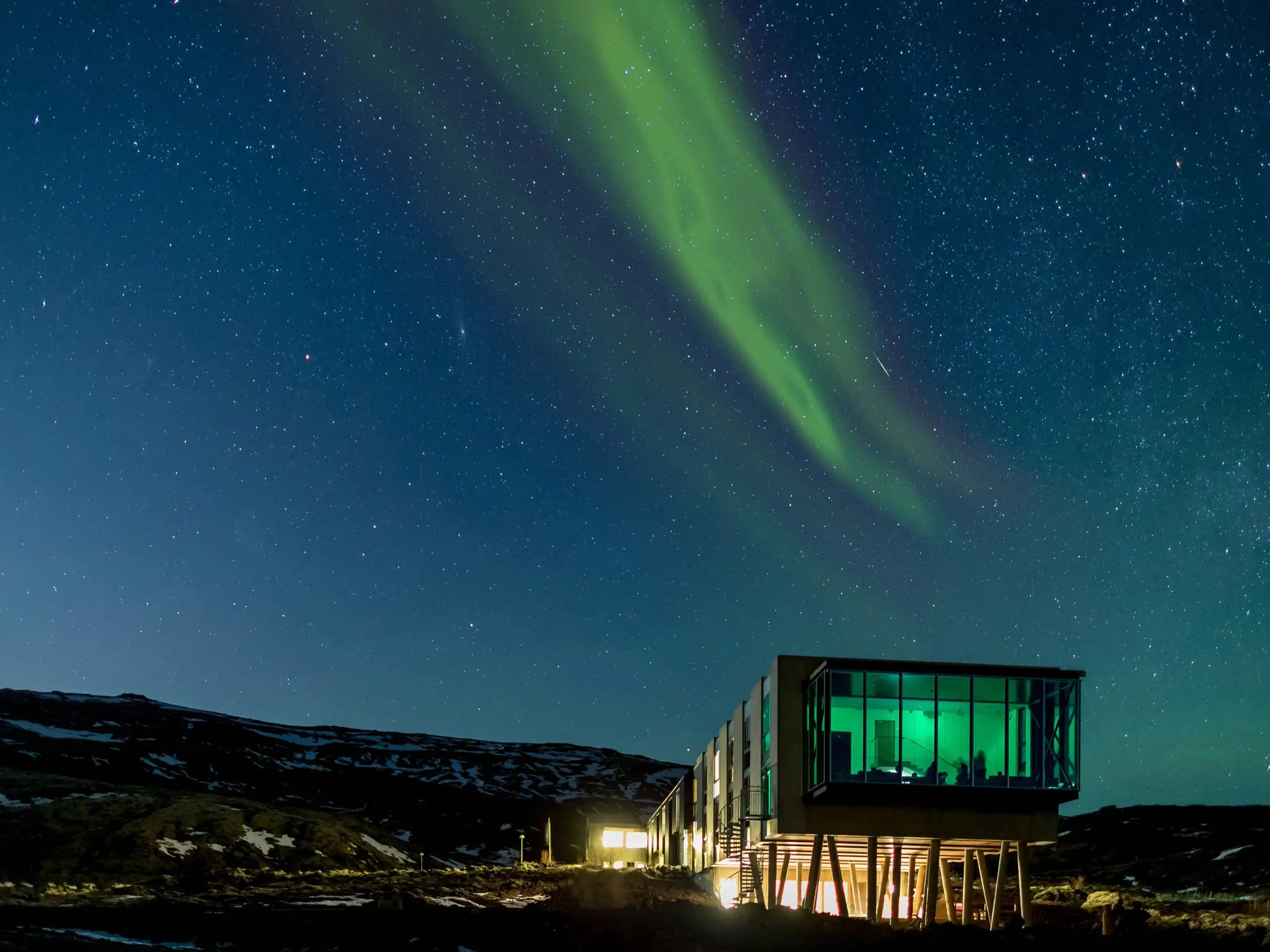 Inside Iceland'sION Luxury Adventure Hotel you'll find the Northern Lights Bar, a bardesigned explicitly for optimal Northern Lights viewing. An hour from Reykjavík, amid mountains and lava fields, sits this glass cage of sorts, which juts out from the end of the hotel and occasionally has astronomers on hand to drop their aurora borealis knowledge.