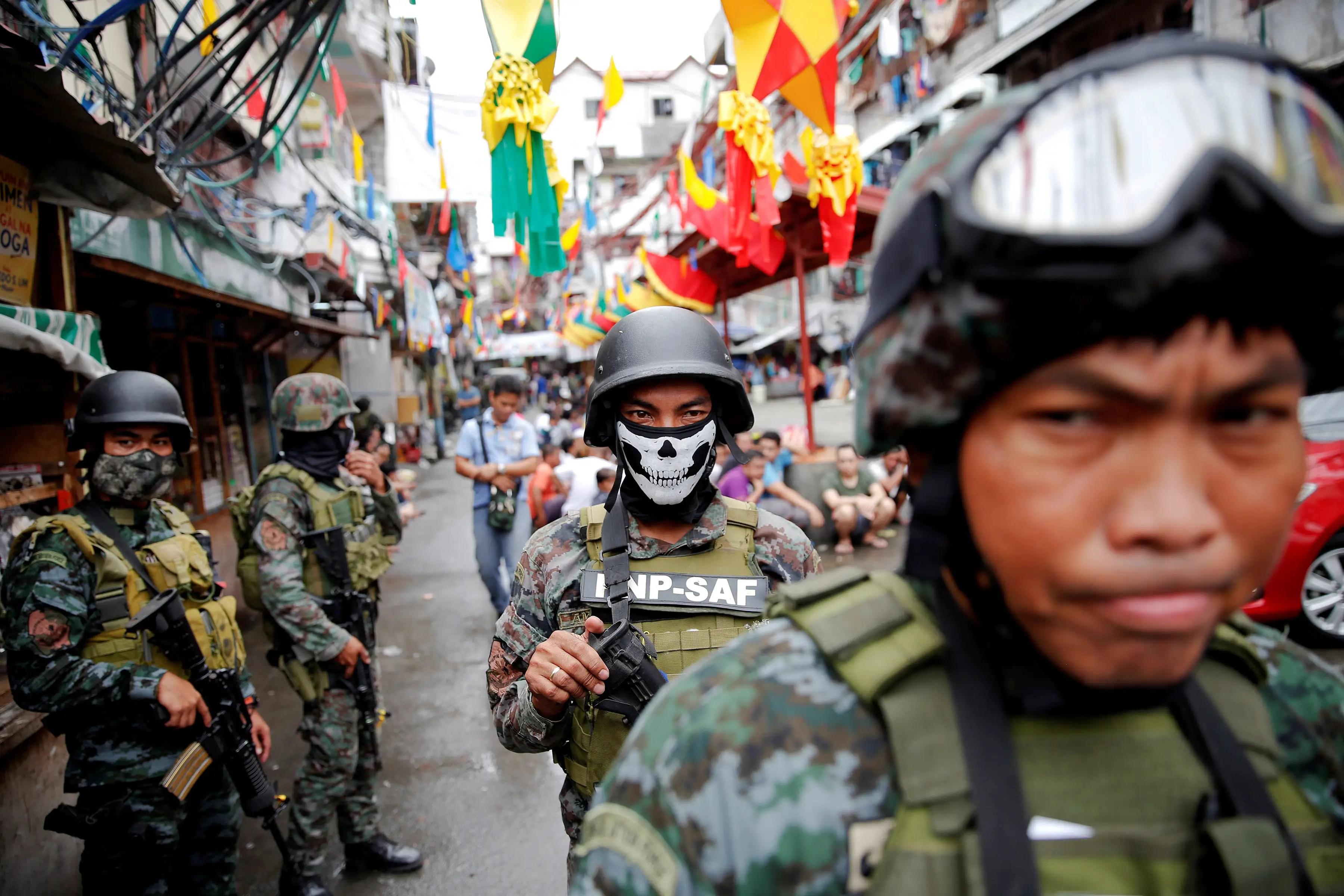Philippines police troops security forces Manila Rodrigo Duterte war on drugs crime violence