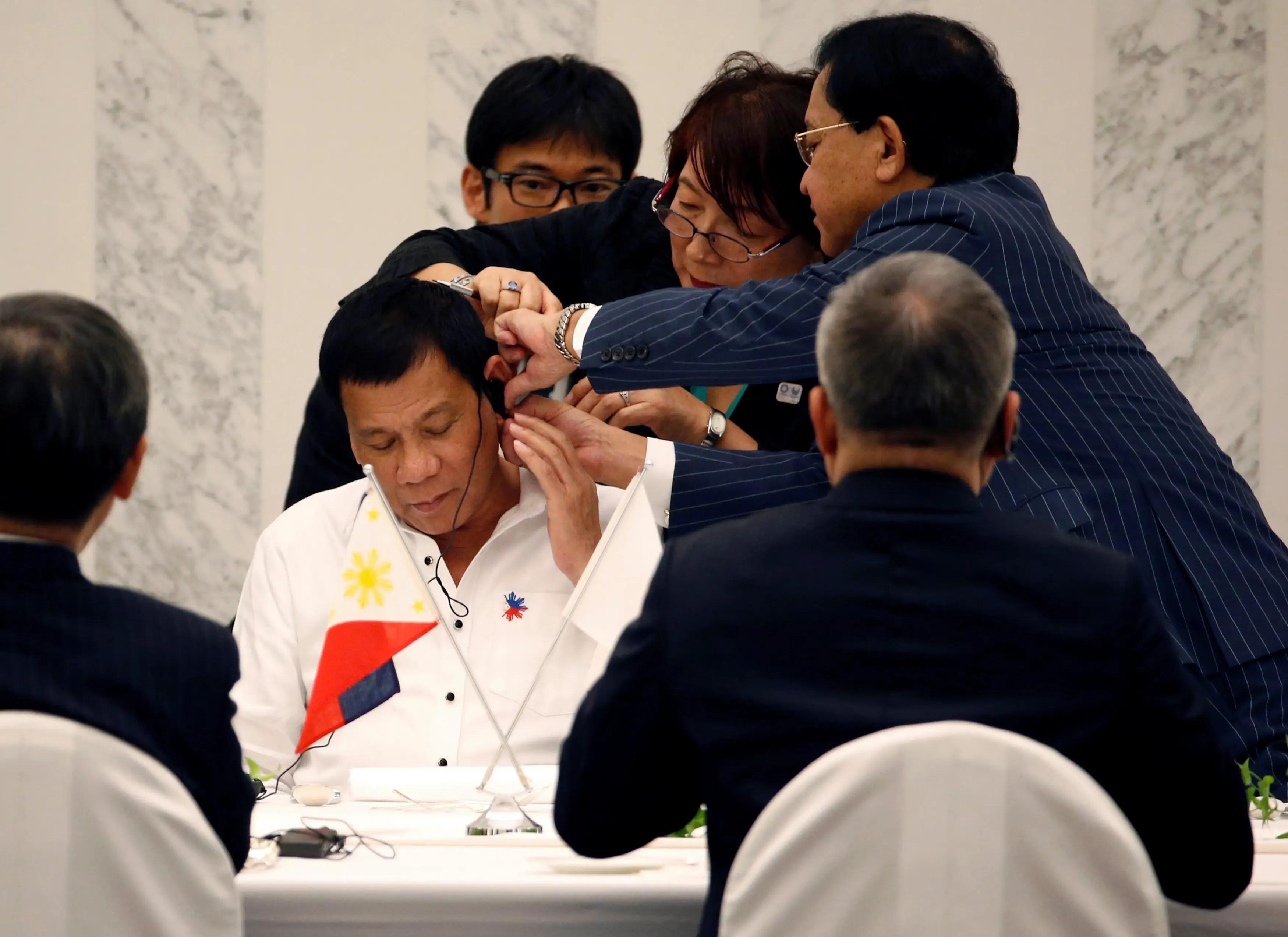 Philippines President Rodrigo Duterte Japan Asia trip visit interpreter