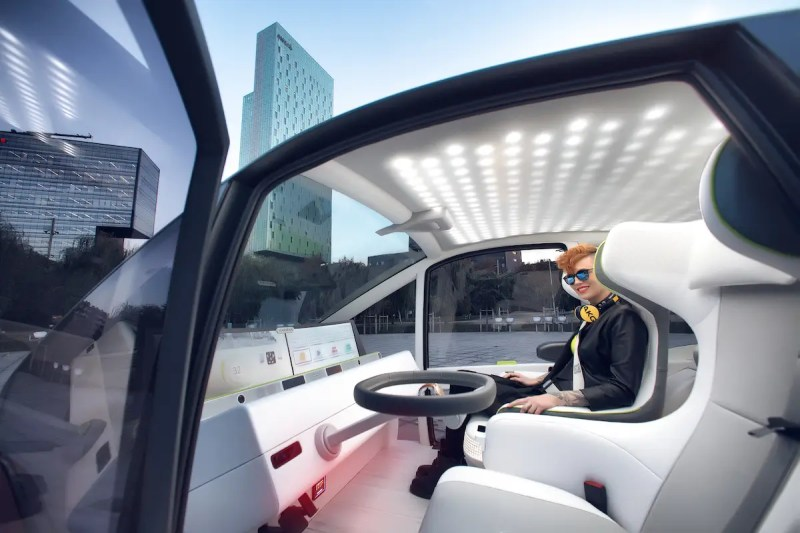 Inside, the car has a massive touchscreen display from Harman that comes with voice and gesture control. The concept can also alert you of upcoming obstacles with a heads-up display on the windshield.
