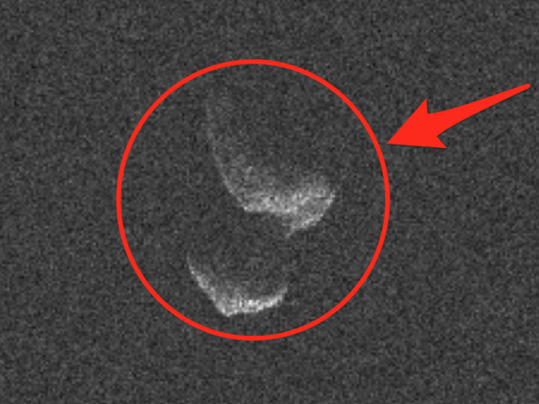 A giant peanutshaped asteroid is flying past Earth and