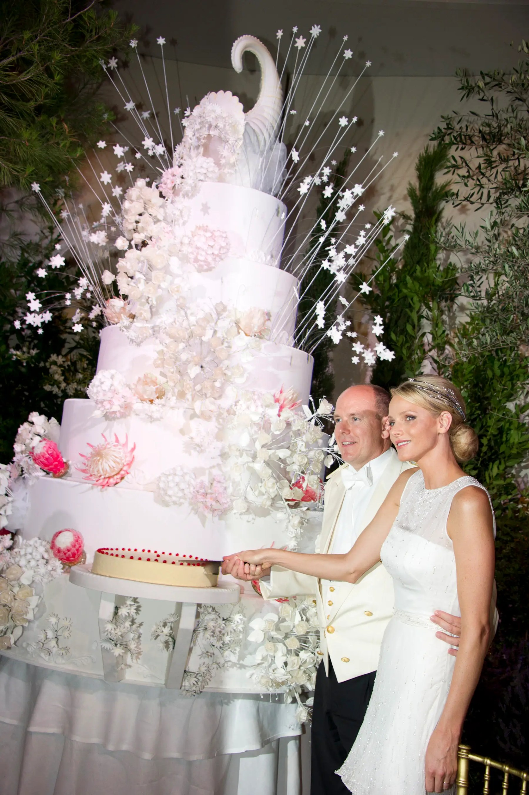 Prince Albert II and Princess Charlene of Monaco's cake was topped with a cornucopia, flowers, and an explosion of stars.