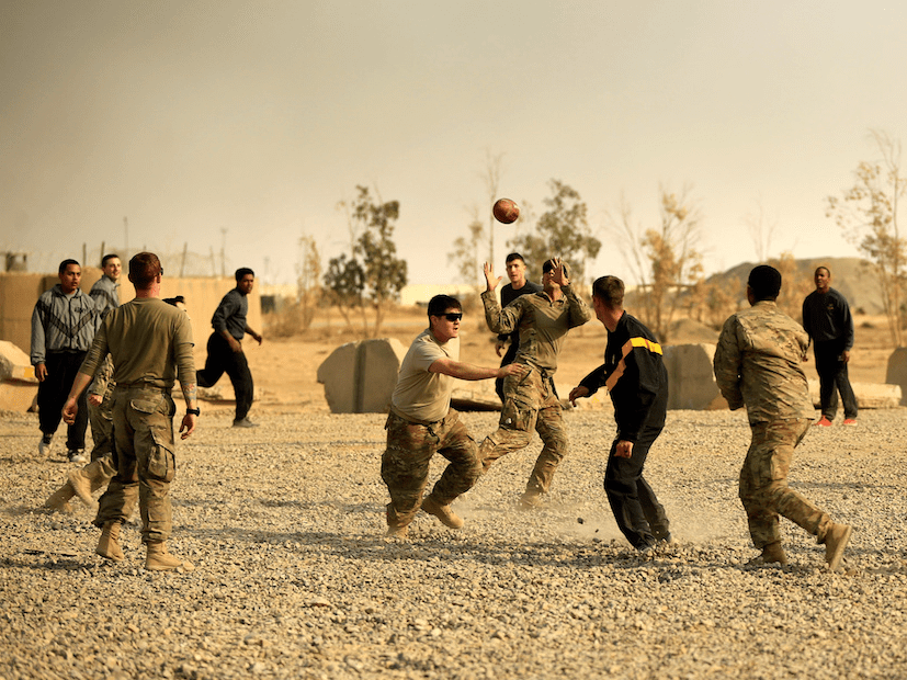 Of course, there are football games on Thanksgiving as well. Here, US soldiers play a game of football on Thanksgiving Day inside the army base in Qayyara, south of Mosul, Iraq in 2016.