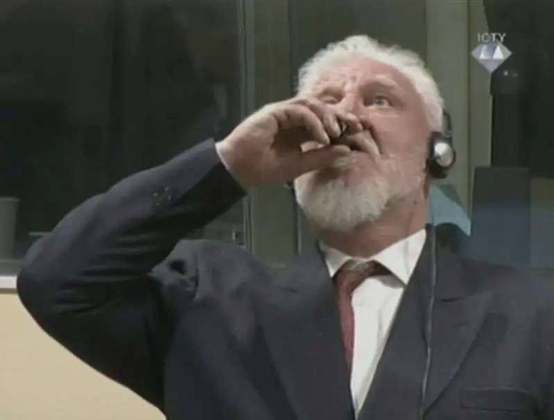 A Croat war criminal's suicide by poison during his trial at the Hague