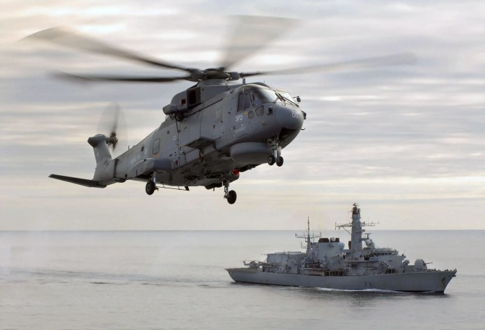 Merlin helicopter HMS Sutherland British Navy send a warship to challenge Beijing's in South China Sea British Navy send a warship to challenge Beijing's in South China Sea merlinhelicopterhoversoverhmssutherlandmod45147560