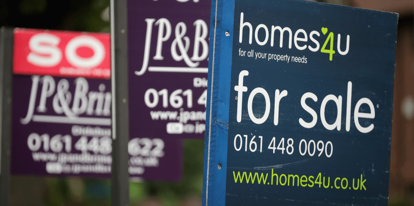 For Sale boards stand outside homes in Didsbury on August 2, 2016 in Manchester, England. Home ownership acroos the country has seen a sharp drop across Britain, particularly in the North. Home ownership in Manchester has fallen from 72% in 2003 to 58% this year according a to a survey by the The Resolution Foundation. (Photo by )
