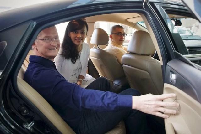 Tim Cook in a car