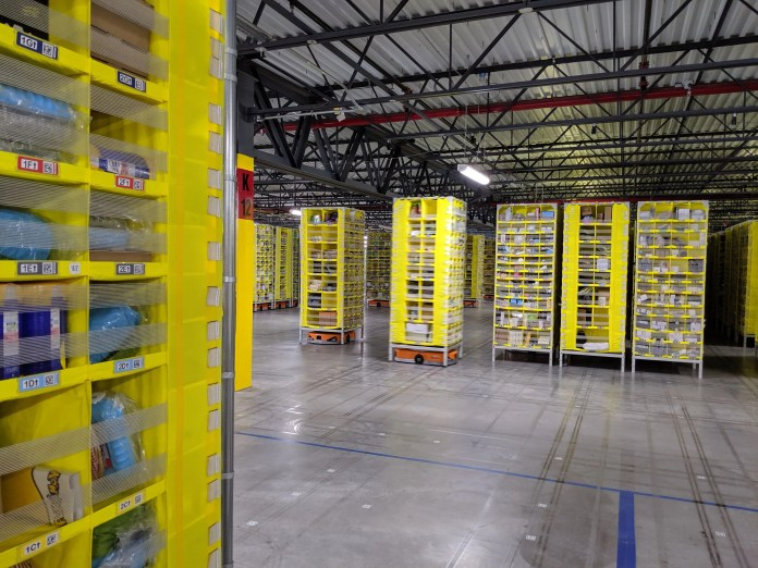 We got inside New York City's first-ever Amazon fulfillment center, where thousands of people work in a building large enough for 18 football fields (AMZN)