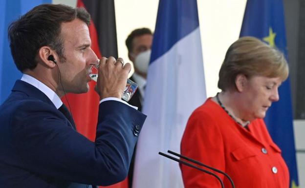 Angela Merkel and Enmanuel Macron