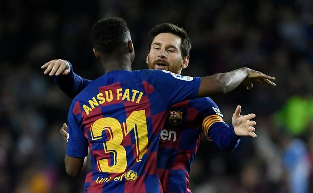 Ansu Fati and Messi celebrate a goal.