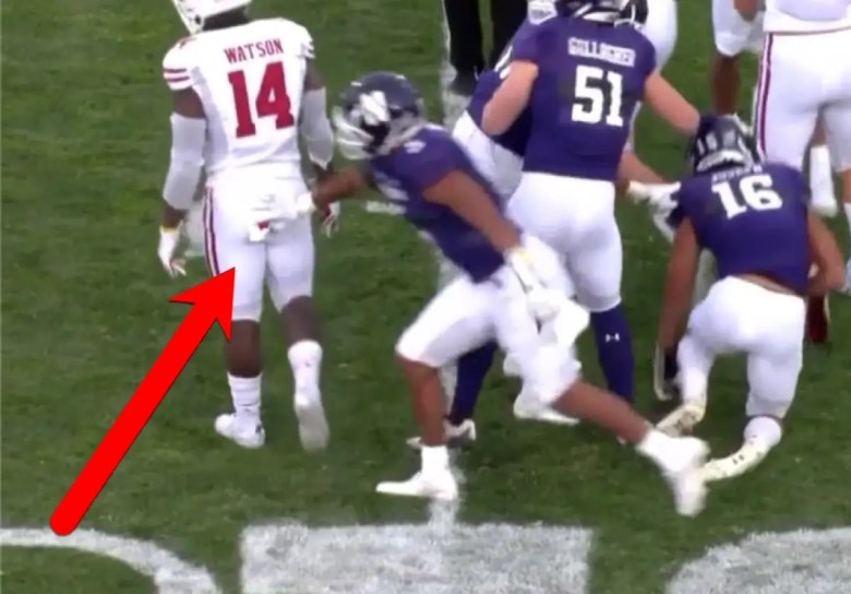 Northwestern Football player takes towels
