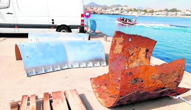 Parts of the municipal outlet damaged and their spare parts, in a dock in Cabo de Palos.