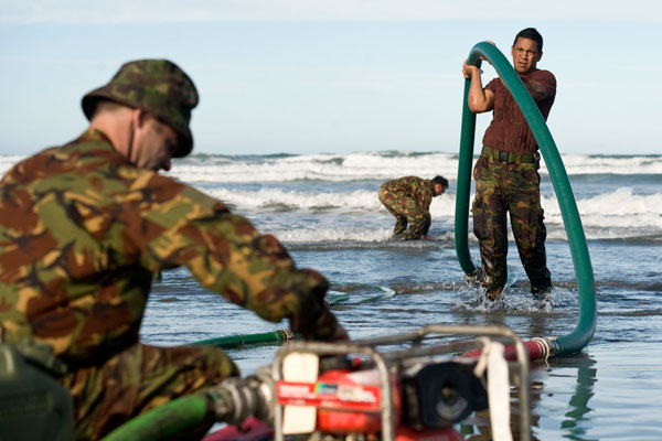 New Zealand army troops take water from the sea to desalinate