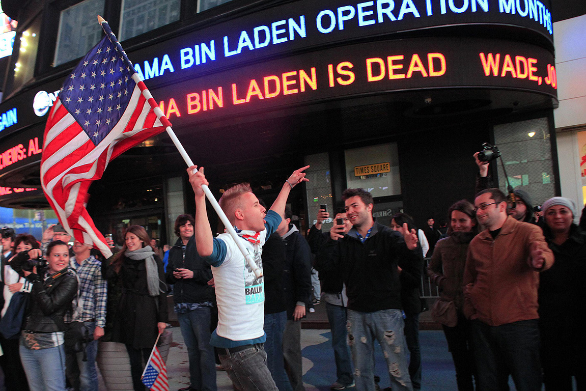 People react to the death of Osama bin Laden in Times Square in New York.