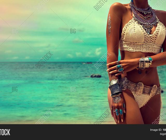 Slim And Tanned Girl In Trendy Boho Style On The Beach Girl In A White
