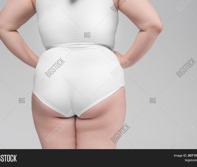 Close Up Of Female Fat Ass Young Woman Is Wearing White Underclothing Isolated