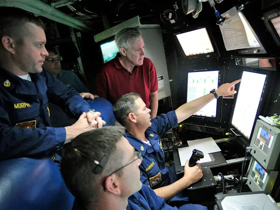 Going further toward the bow of the sub, the command center is directly beneath the main sail of the sub and where the navigators do their work