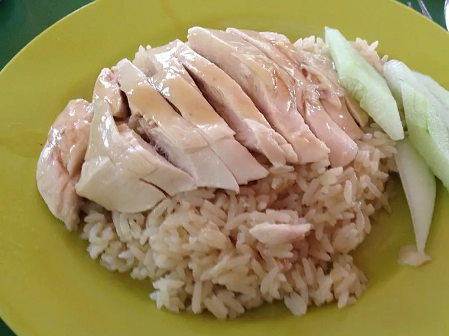 Chicken rice is Singapore's unofficial national dish. First, chicken is boiled in a flavorful broth. Then the rice is cooked in that same broth. The result is a fragrant, flavorful, succulent rice that pairs perfectly with the juicy chicken.