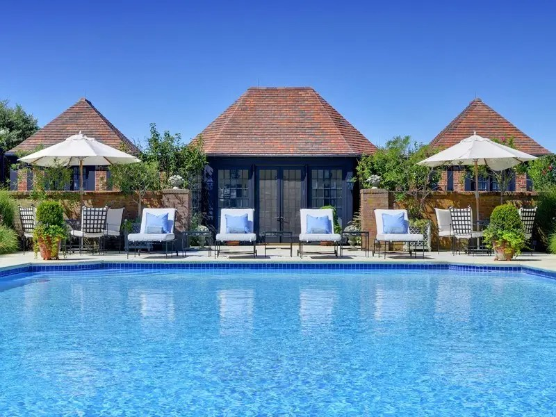 And don't forget lounging by the serene pool, complete with pool house and chairs.