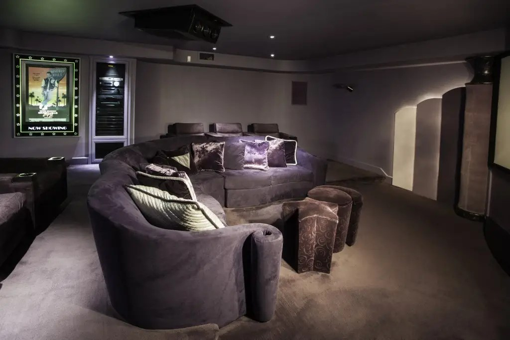 Or sit on yet another purple couch as you watch a movie in the screening room.