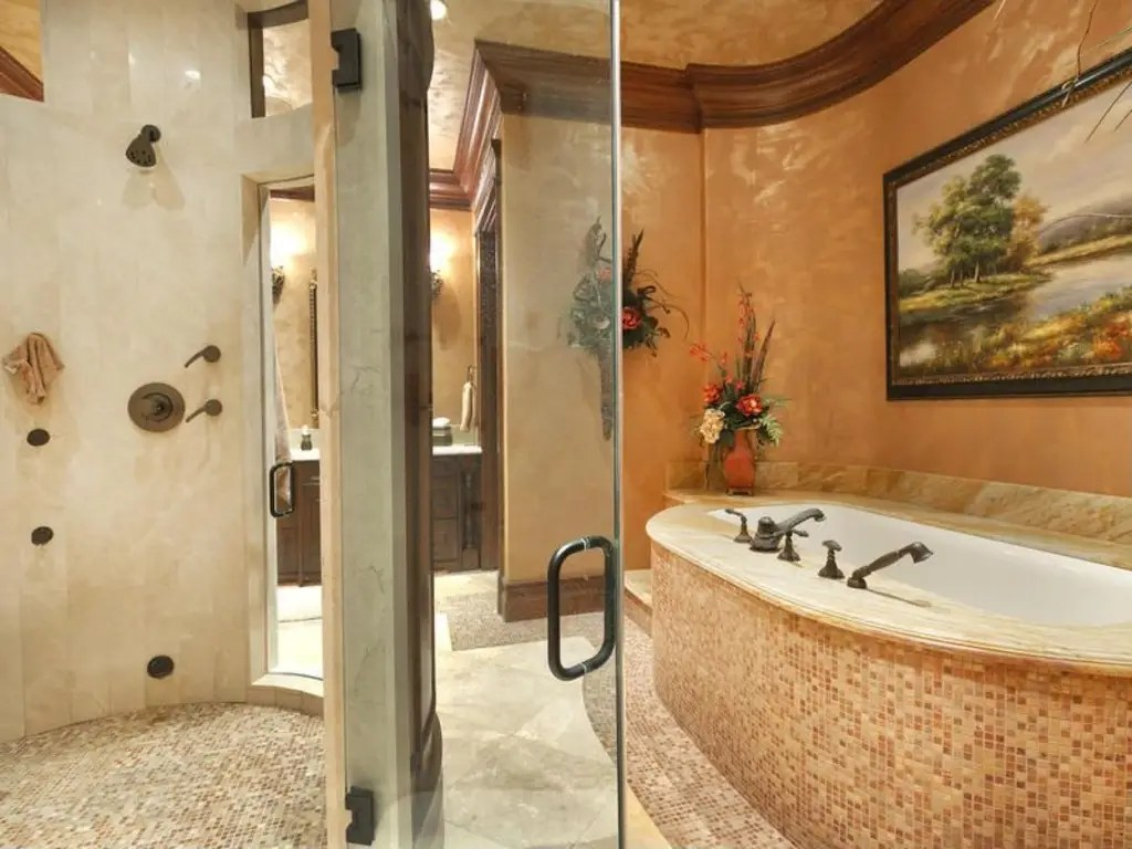 And here is the master bath with a soaking tub, steam shower, and his and hers sinks.