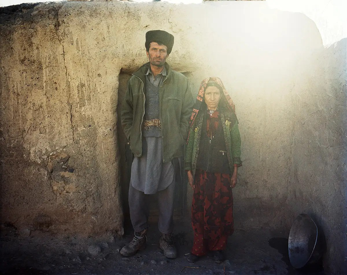 Amir Muhammad was one of the expedition's porters. He stands with his mother in front of their home.