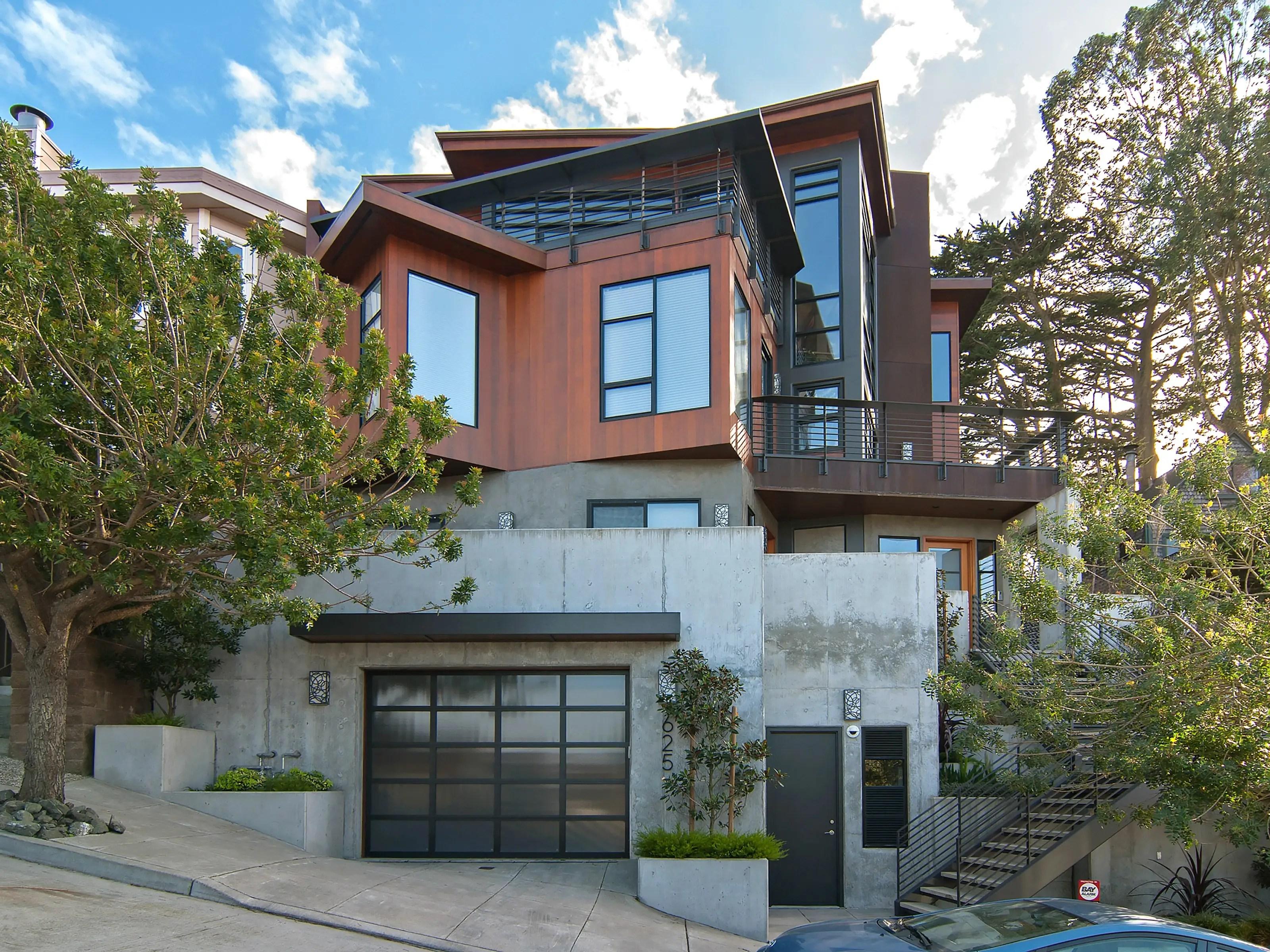 The four-bedroom, six-bathroom home has a modern, angular facade.