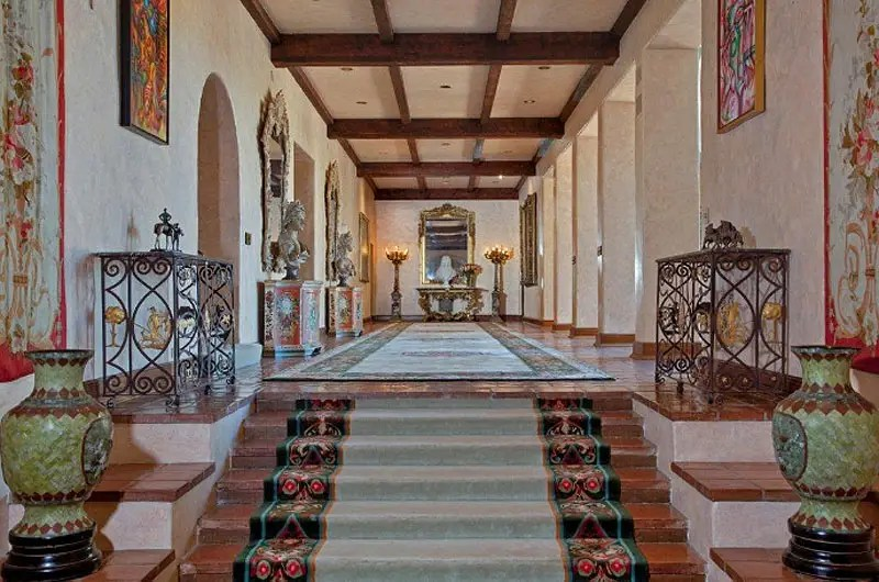 The inside of the home is just as grand as its exterior, with 22-foot-high detailed ceilings.