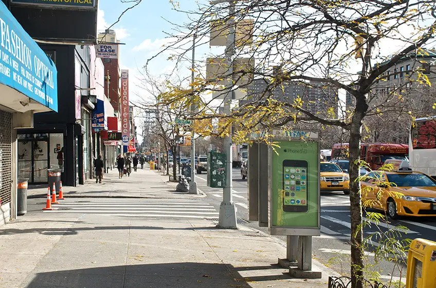 2013: Today, Delancey Street is much cleaner and has more trees (though you can still see the Manhattan Bridge!).