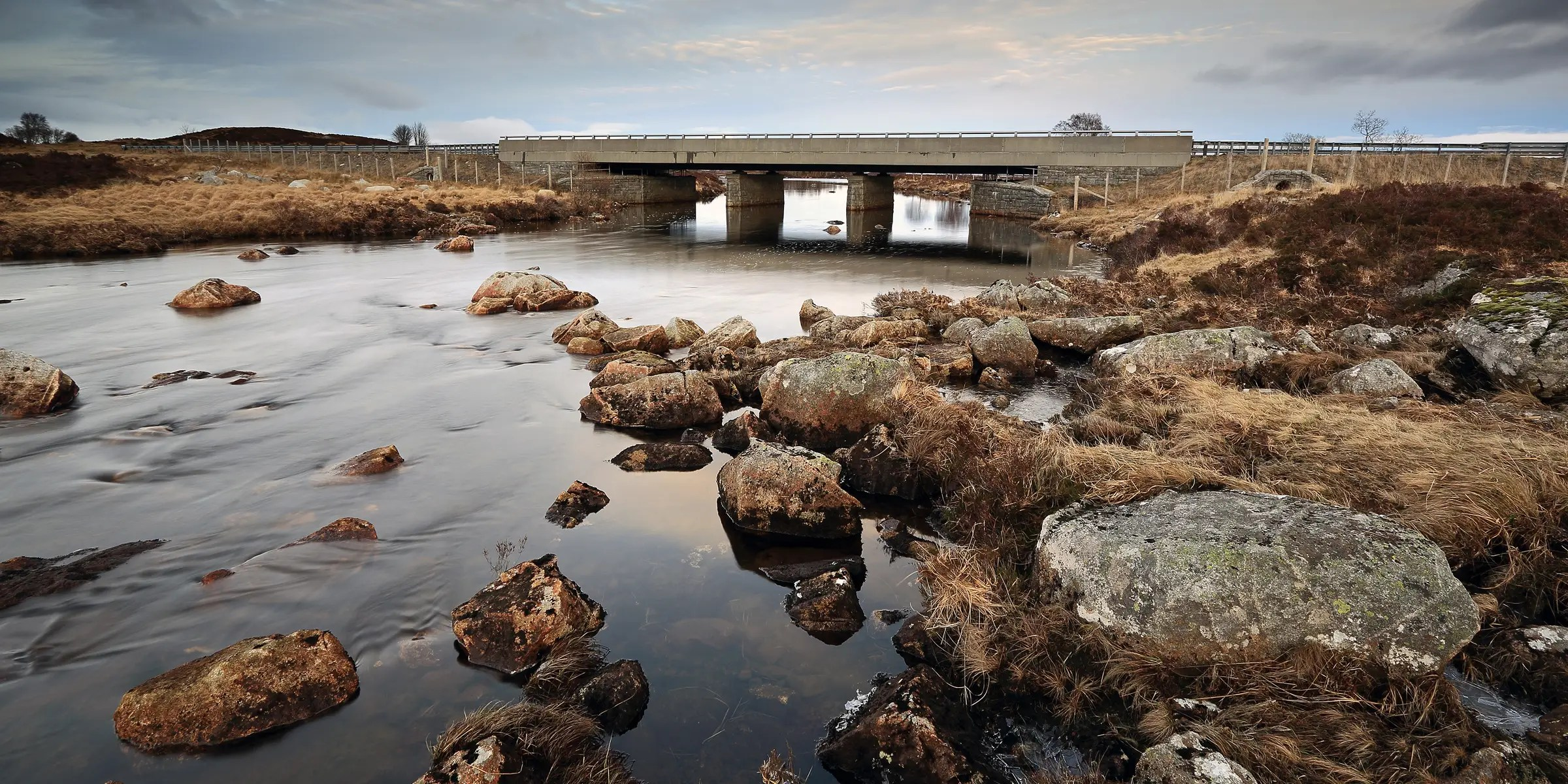The long, remote A82 Road in Glencoe, Scotland, brings you breathtaking scenic spaces and wonderful sights like the Rannoch Moor Bridge.