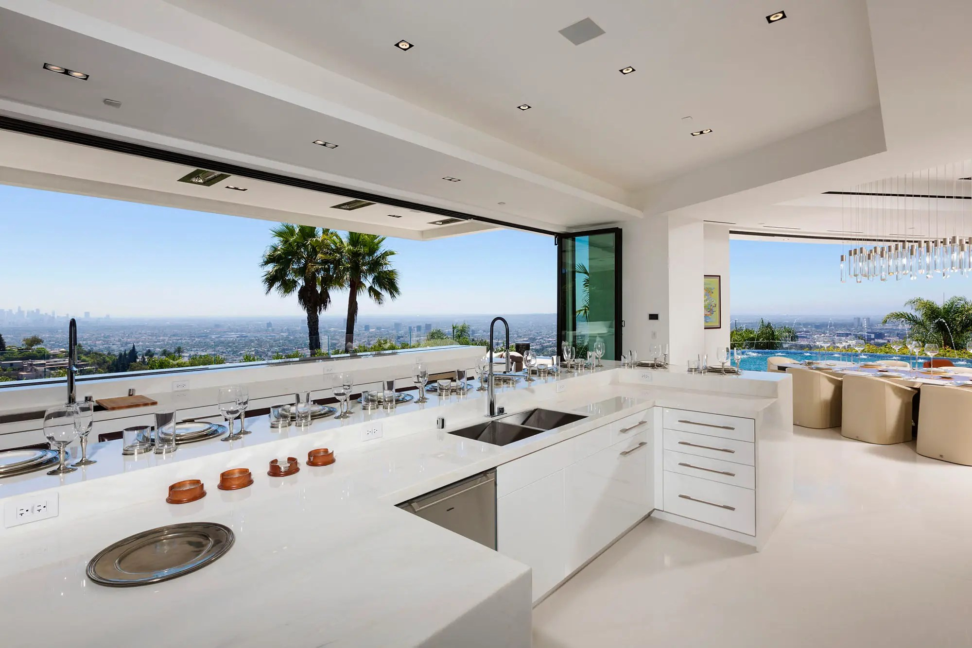 The open kitchen has 10 bar stools and a nearly 180-degree view of downtown LA.
